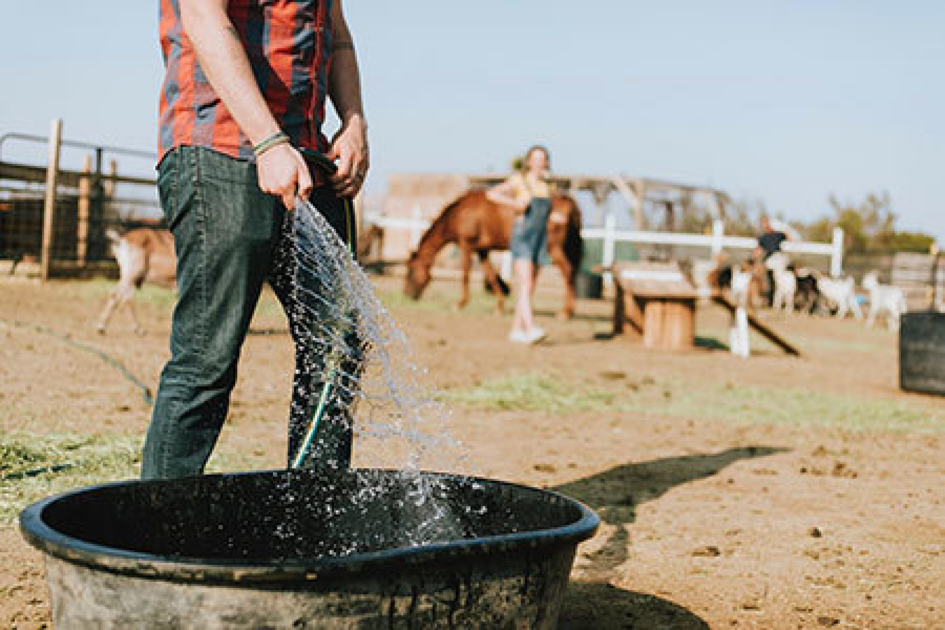 Man Filling Tub With Water