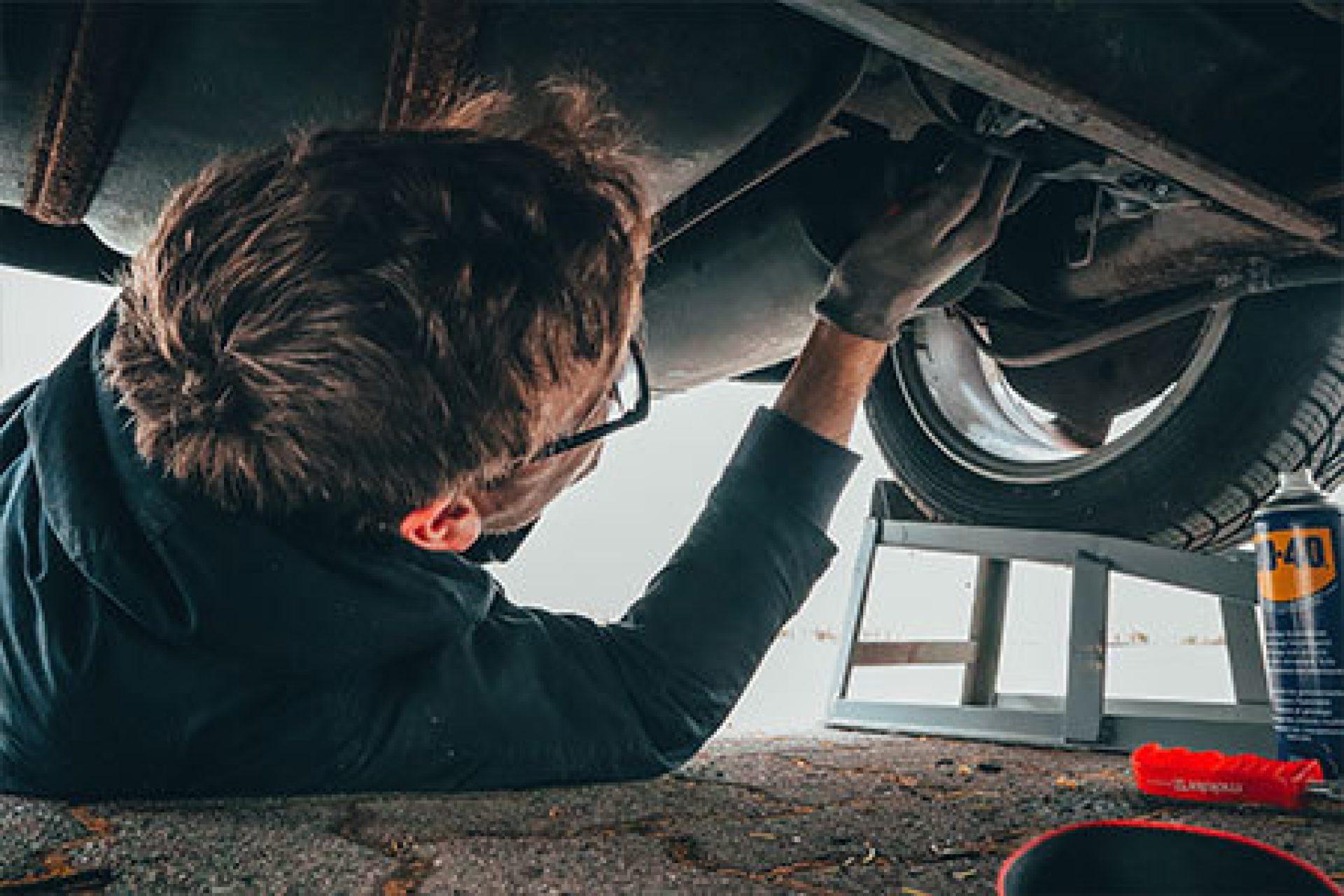Man Fixing Engine
