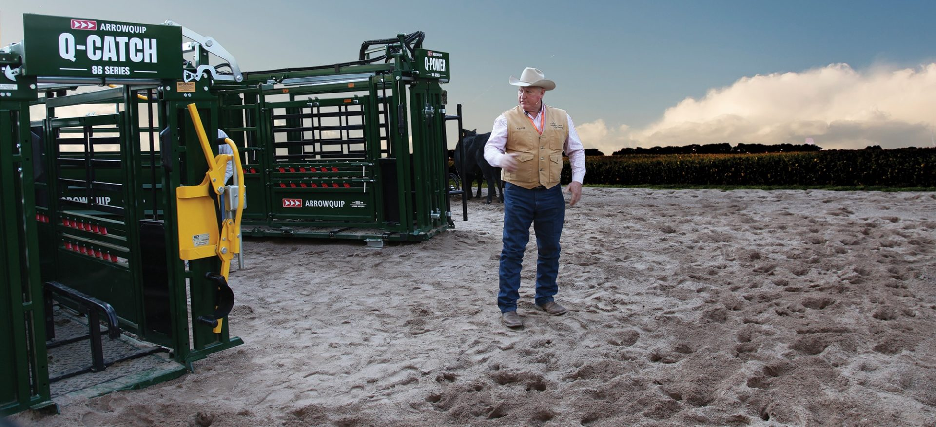 Dr Ron Gill standing next to Q-Catch 86 Series Cattle Chute and Q-Power 106 Series Hydraulic Chute at the NCBA