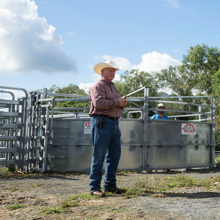 Stockmanship expert Dr. Ron Gill speaking at cattle handling training session in Australia