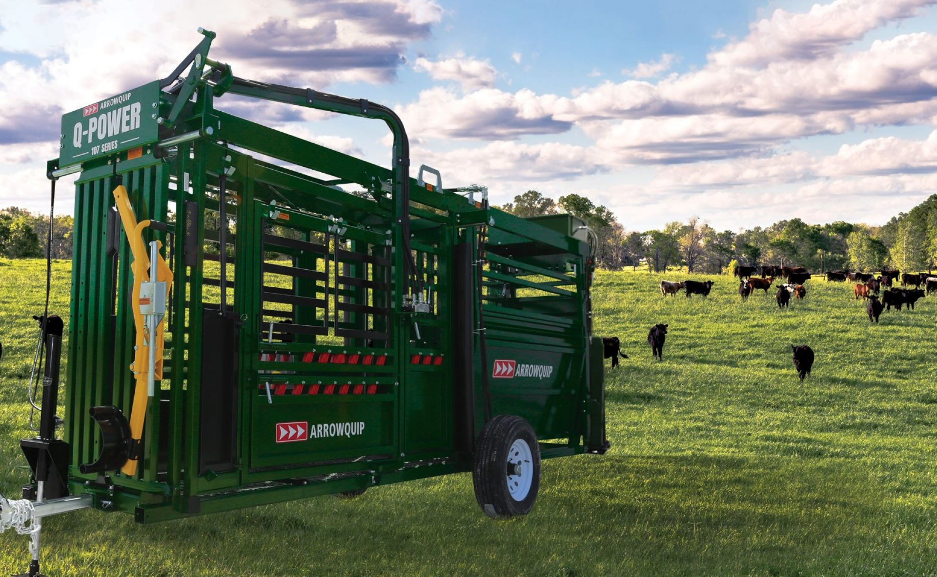 hydraulic mobile crush in a field with cattle
