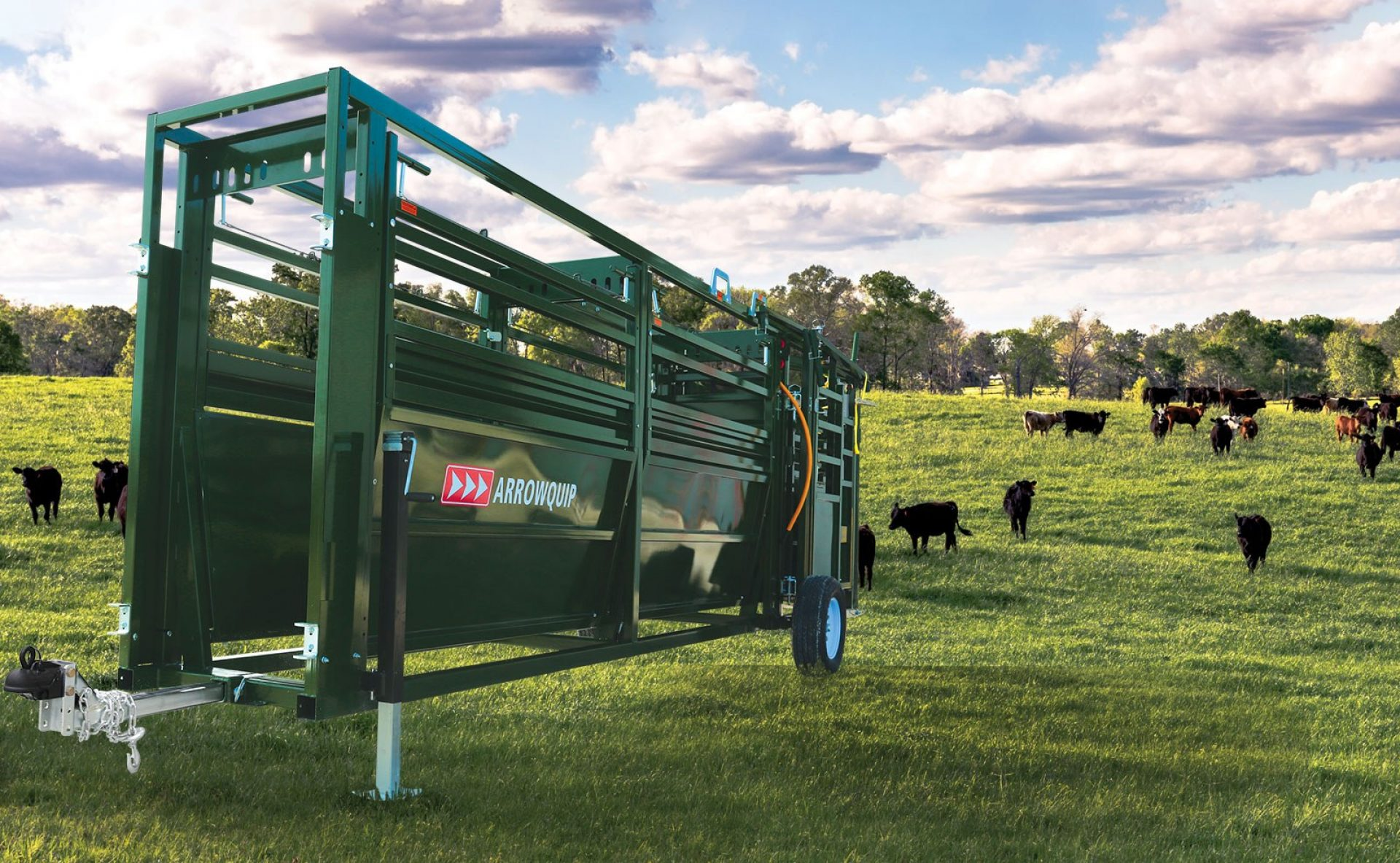 Portable cattle tub and alley sitting in a field prepared for towing