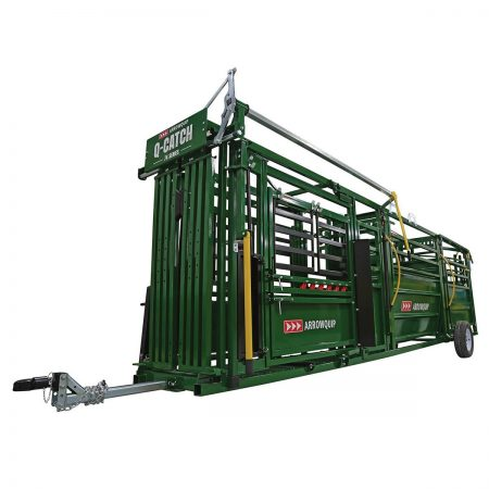 portable cattle handling system in towing position on white background
