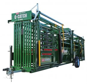 Side profile of Q-Catch 87 Series portable cattle chute, alley, and tub ready for towing